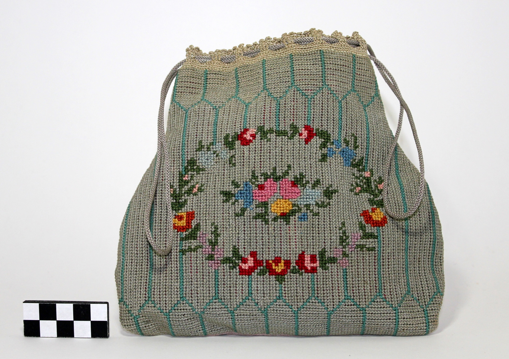 Blue needlework Victorian purse with flower in the middle